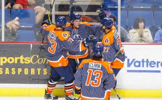 The Oilers celebrate a goal in Sunday game with Missouri.