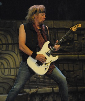 "Guitarist Adrian Smith of Iron Maiden performs during the group's ""Book of Souls"" tour stop Friday night at the BOK Center in Tulsa"